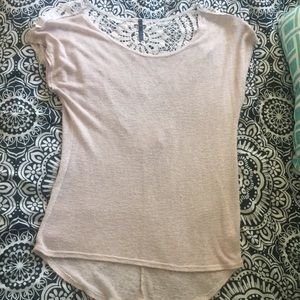 Cream color top with a lace v on the back